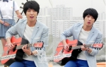 Lee Shin with his guitar