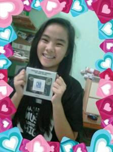 Dada Vee's daughter Erika - Winner of 1Boice International Donor Raffle. Prize: CNBLUE Minhyuk Badge Set